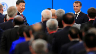 Chinese President Xi Jinping and French President Emmanuel Macron attend the opening ceremony of the second China International Import Expo (CIIE) in Shanghai, China November 5, 2019