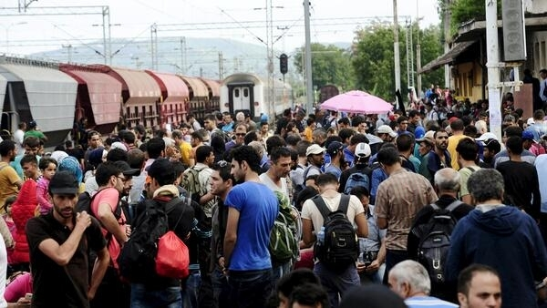 Refugees in a train station in Macedonia on  22 August.