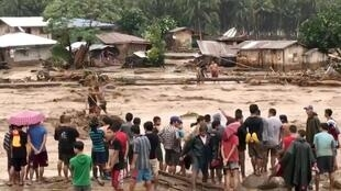 People help to rescue flood victims in Lanao del Norte, Philippines, December 22, 2017 in this image taken from video footage obtained from social media.