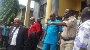 Charles E. Sirleaf (c), son of Liberia's former president, being escorted by the Liberian court sherriff, Monrovia