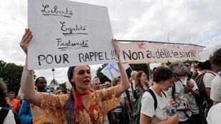 Demonstrators in Paris welcome participants in a migrants' solidarity march across France in June