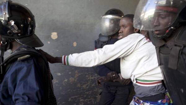 A demonstrator is arrested in Dakar on Sunday