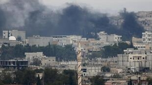 Smoke rising from fighting between Kurdish fighters and the Islamic State armed group in the Syrian city of Kobane
