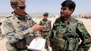 A French army officer with an Afghan officer in Uruzgan province in 2009
