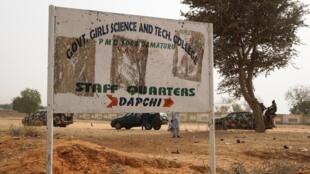 Soldier pass school sign in Dapchi, Yobe state