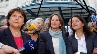 French Socialist party First Secretary Martine Aubry (L), legislative elections candidate in La Rochelle Segolene Royal (C) and Green Party leader Cecile Duflot speak to journalists as they arrive in La Rochelle, south-western France, June 12, 2012.