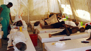 Haitians cholera victims receive treatment inside a hospital run by Doctors Without Borders in Port-au-Prince