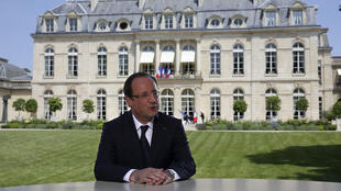 François Hollande during the televised interview in the Elysée Palace gardens.