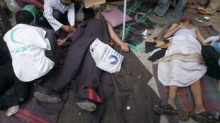 Medics treat injured protesters after clashes with police in Sanaa