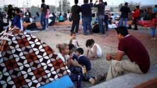 Des Mexicains fuyant la violence font la queue pour demander l'asile aux États-Unis, à Ciudad Juarez, le 22 septembre 2019.