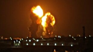 Two balls of fire are seen following an Israel airstrike in Khan Yunis in the southern Gaza Strip early on November 15, 2019.