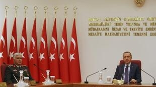 Turkey's Prime Minister Tayyip Erdogan (R) chairs the annual meeting of the Supreme Military Council (YAS) as he is flanked by Ground Forces Commander and acting Chief of Staff General Necdet Ozel in Ankara 1 August 2011.