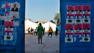 Residents play football in a Port au Prince school being used as a polling centre for presidential elections