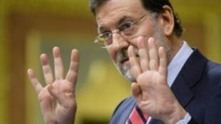 O primeiro-ministro espanhol, Mariano Rajoy, comprometeu-se a reduzir o déficit público do país.