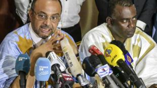 Sidi Mohamed Ould Boubacar (G) et Biram dah Abeid (D) lors d'une conférence de presse le 23 juin 2019. (Photo d'illustration)
