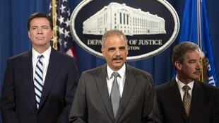 US Attorney General Eric Holder (C) with his deputy James M Cole (R) and FBI director James B Comey (L) after BNP pleaded guilty