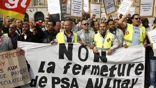 Peugeot workers demonstrate against job losses and factor closures