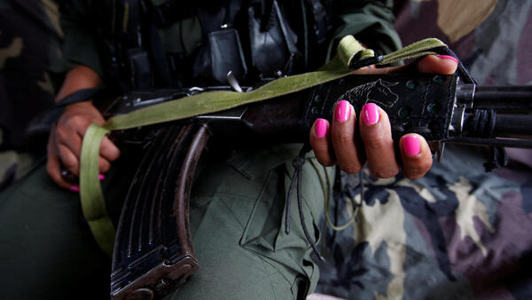A member of the Farc at a camp in Cordillera Oriental, Colombia