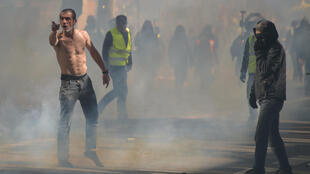 Yellow Vest protesters in Toulouse surrounded by tear gas during a demonstration on 13 April, 2019.