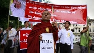 A Buddhist monk and other protesters demonstrate against Time magazine in Yangon 30 June 2013.