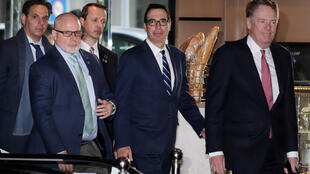 Members of the U.S. trade delegation Robert Lighthizer and Steven Mnuchin arrive at a hotel in Beijing, China March 28, 2019.  Lee