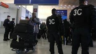 French police check security during strike at Paris CDG airport