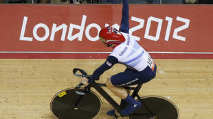 Britain's Chris Hoy celebrates after their track cycling men's team sprint finals at the Velodrome, 2 August, 2012