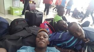 Francine Niyonsaba (centre) took a photograph of herself and fellow athletes camping on the floor at Lagos Airport and posted the image on social media.