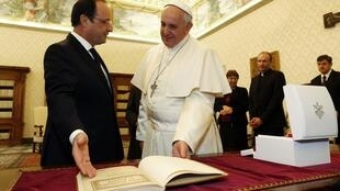 Pope Francis meets François Hollande at the Holy See on 24 January.