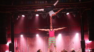 All Cirque Mandingue troupe members form a human tower