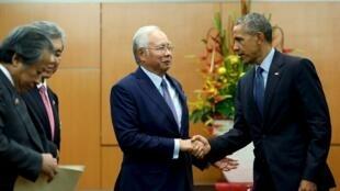 Presidente Barack Obama e o Primeiro-Ministro da Malásia  Najib Razak antes da cimeira da ASEAN em Kuala Lumpur.20 de Novembro 2015