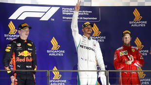 Lewis Hamulton (centre) claimed the Singapore Grand Prix to move 40 points ahead of Sebastian Vettel (right) who finished the race in third. Max Verstappen (left) was second.