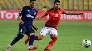 ES Tunis' Tunisian forward Anice Badri vies for the ball against Al-Ahly FC's Egyptian defender Sabri Raheel