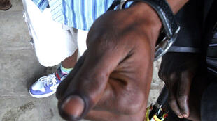"""""""I've voted, check out my indelible ink"""" - Voter at Institut De La Gombe in Kinshasa"""