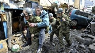A man is saved from the wreckage caused by Japan's earthquake
