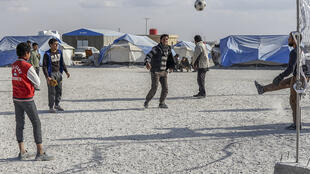 Ain Issa camp youth playing football in Ain Issa camp, Syria.