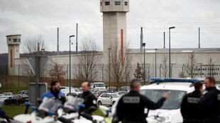 French police in postion outside the prison where an inmate in one of France's most secure prisons stabbed two guards with a knife in Conde-sur-Sarthe, France, March 5, 2019
