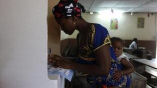 A voter in Abidjan
