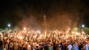 ក្រុមជាតិនិយម in a torch-lit march on the grounds of the University of Virginia ahead of the Unite the Right Rally in Charlottesville, Virginia on August 11, 2017. Picture taken August 11, 2017.