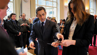 President Nicolas Sarkozy and his wife Carla Bruni-Sarkozy cast their votes at a polling station in Paris.