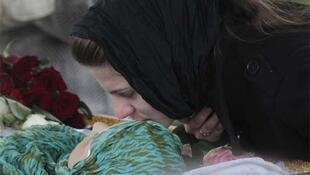 A relative kisses Anna Permyakova, 35, a victim of the metro blasts