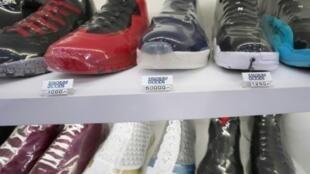Unas zapatillas Air Jordan 11 Jeter shoe (C) en Stadium Goods el 6 de junio de 2018  en Nueva York
