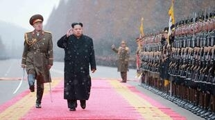 North Korean leader Kim Jong Un salutes during a visit to the Ministry of the People's Armed Forces on the occasion of the new year, in this undated photo released by North Korea's Korean Central News Agency