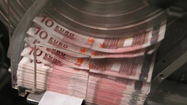 A machine counts and sorts out euro notes at the Belgian Central Bank