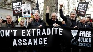 Former Greek Finance minister Yanis Varoufakis, fashion designer Vivienne Westwood, editor in chief of WikiLeaks Kristinn Hrafnsonn, Assange's Father John Shipton and singer Roger Waters attend a protest against the extradition of Julian Assange.