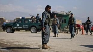 An Afghan policeman next to a checkpoint at Bagram