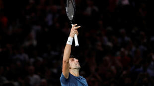 Novak Djokovic moved into the final of the Rolex Paris Masters after a three hour match against Roger Federer.