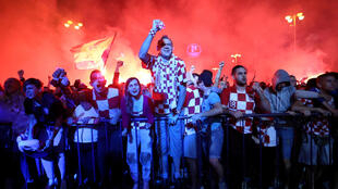 Croatia's fans react after a goal as they watch the broadcast of the World Cup semi-final match between Croatia and England in the fan zone.