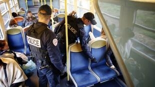French policemen take part in a security operation in a RER D suburban train.