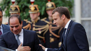 French President Emmanuel Macron greets Egyptian President Abdel Fattah al-Sisi as he leaves the Elysee palace in Paris, France, October 24, 2017.